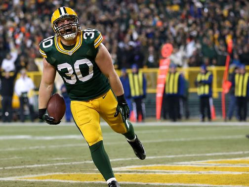 John Kuhn: Celebrates one of his two touchdowns