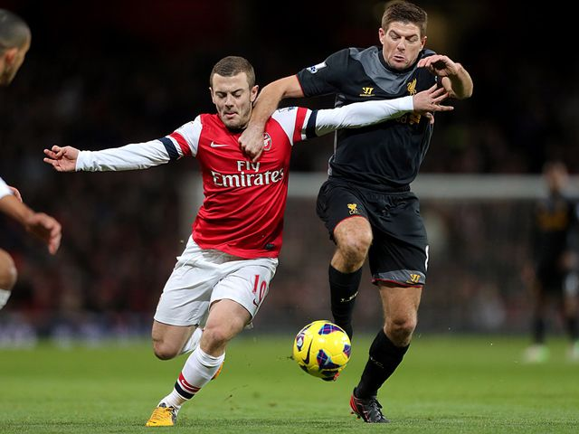 Jack Wilshere and Steven Gerrard battle for possession