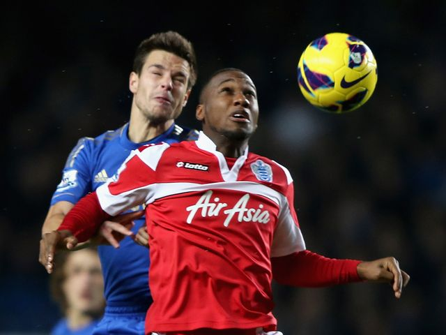 Cesar Azpilicueta and Junior Hoilett in aerial battle