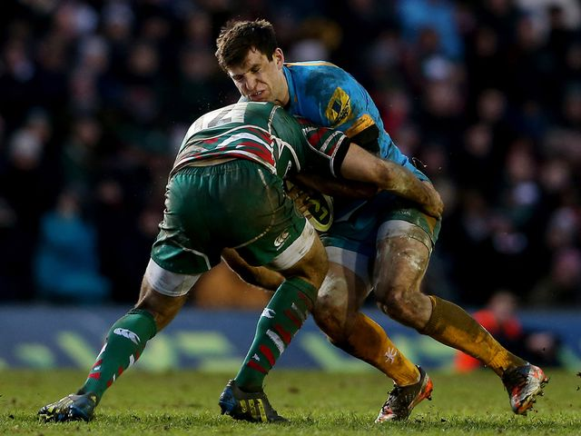 Wasps' Charlie Hayter is stopped by the Leicester defence