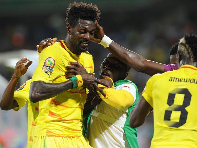 Adebayor celebrates his opening goal