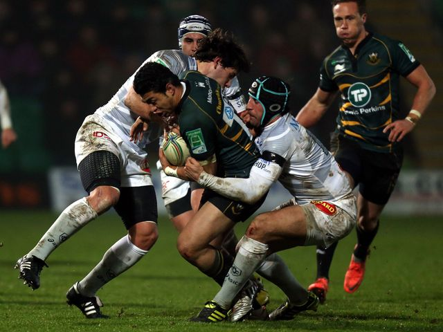 Northampton's George Pisi is tackled