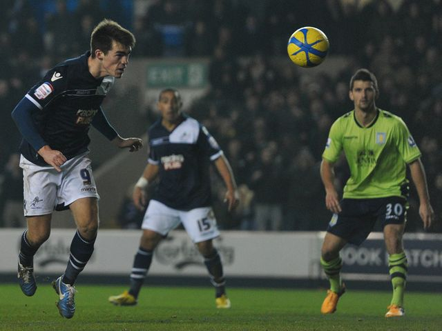 John Marquis heads home Millwall's late winner
