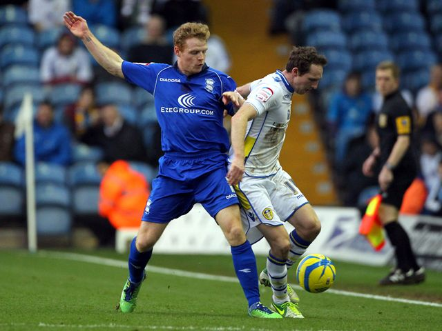 Chris Burke and Aidan White battle for the ball