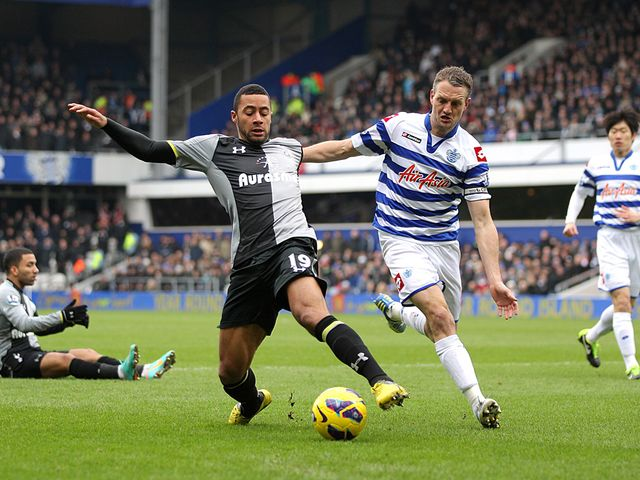 Mousa Dembele and Clint Hill battle for the ball