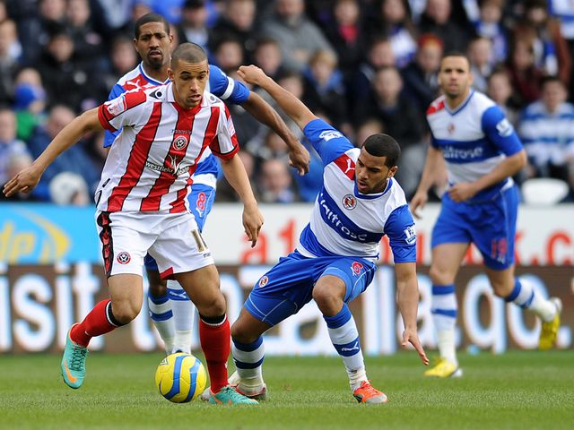 Neil Blackman is tackled by Adrian Mariappa