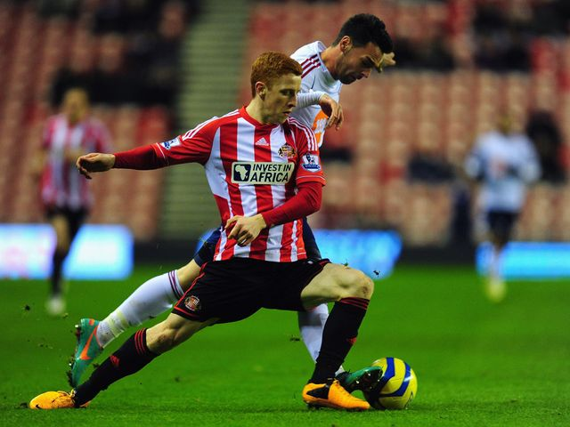 Jack Colback and Chris Eagles battle for the ball