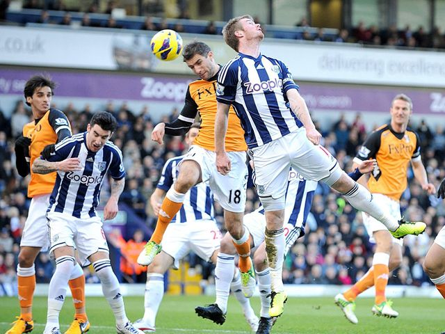 Aaron Hughes and Chris Brunt compete for the ball