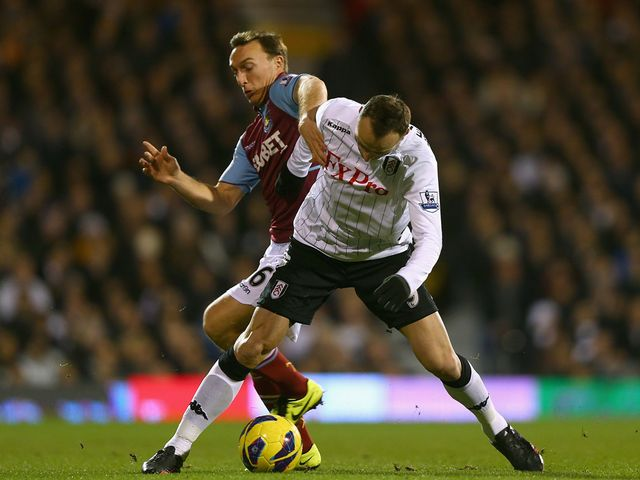 Mark Noble and Dimitar Berbatov tussle at Craven Cottage