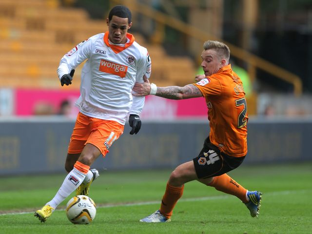 Tom Ince looks to get past Jamie O'Hara