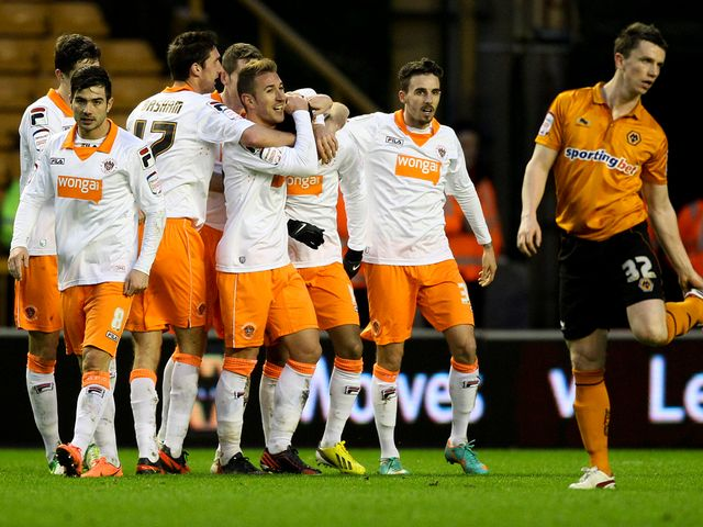 Thomas Ince is mobbed after scoring