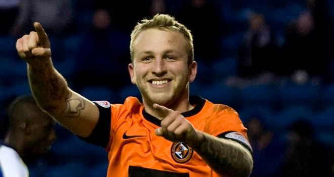 Johnny Russell: Celebrates his hat-trick at Kilmarnock