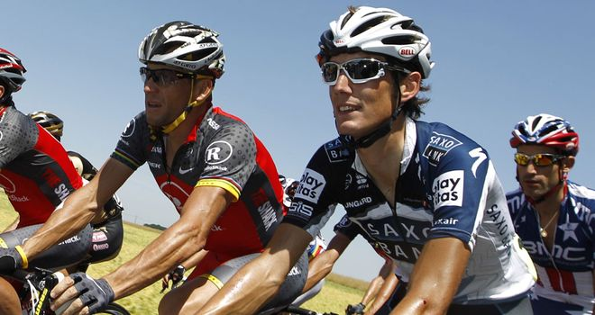 Andy Schleck (right) is not sure whether Lance Armstrong (left) will confess to doping.