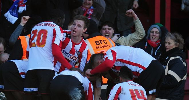 Brentford's players celebrate scoring against Chelsea