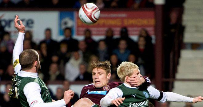 Marius Zaliukas: Sandwiched between Hibs defenders at Tynecastle