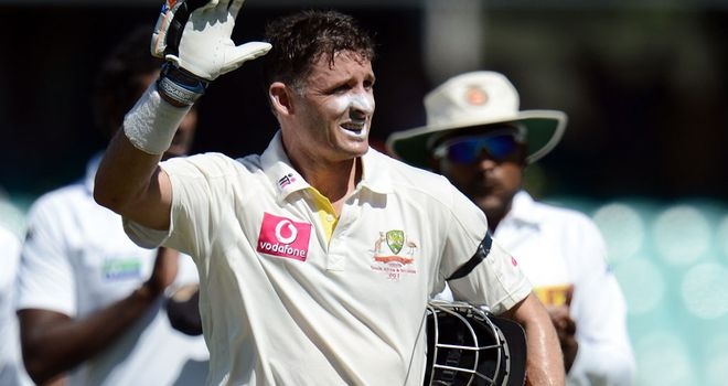 Mike Hussey waves to the crowd as he exits the Test arena for the final time