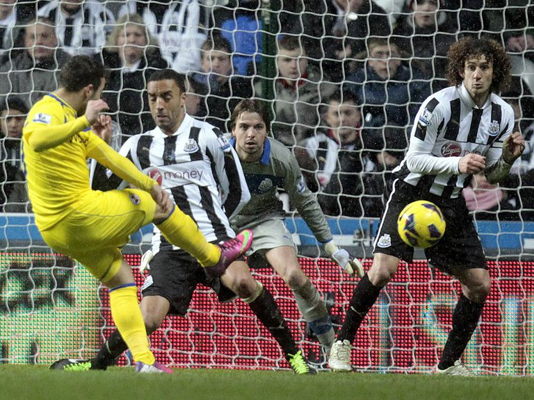 Reading's Adam Le Fondre scores one of his two goals at Newcastle