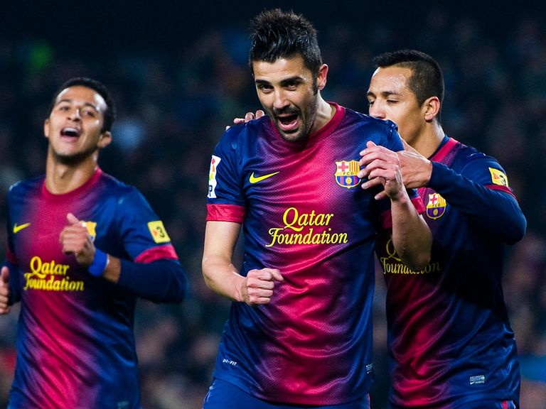 Villa (centre) will be staying at Barcelona