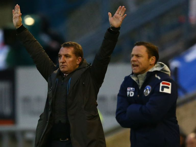 Dickov (right) got the better of Brendan Rodgers
