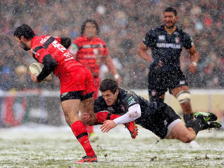 Leicester beat Toulouse in the snow to march on.