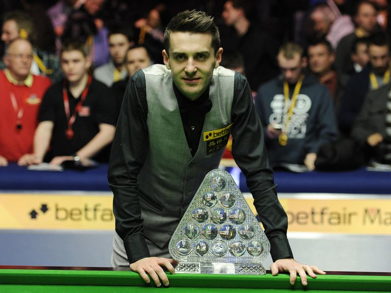 Mark Selby poses with the Masters trophy.