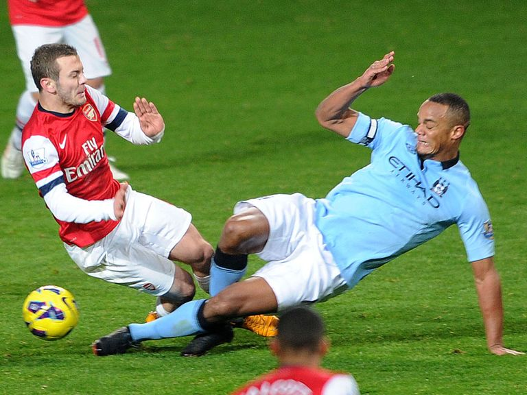 Kompany saw red for this challenge on Wilshere