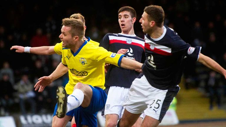 Dundee's Lewis Toshney (far right) scores against Morton