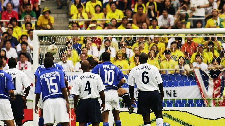 Ronaldinho's free-kick drops into the England net at the 2002 World Cup