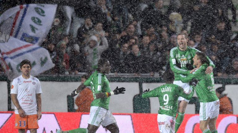 St Etienne celebrate in the snow against Montpellier