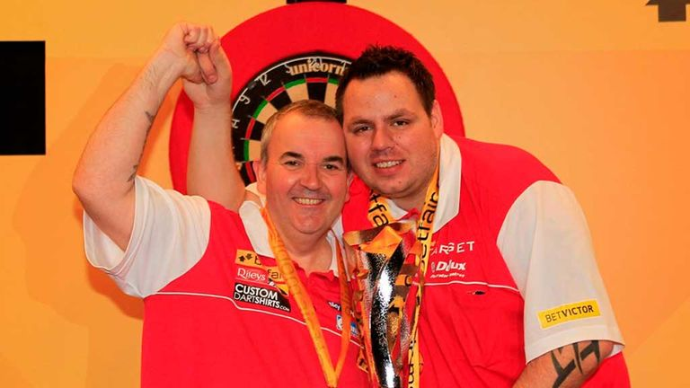 On top of the world: Adrian Lewis and Phil Taylor are looking to lift the World Cup of Darts again this weekend