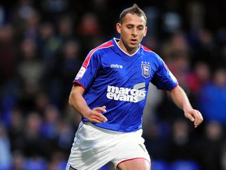 Ipswich: Will bear owners' name on shirt for another year