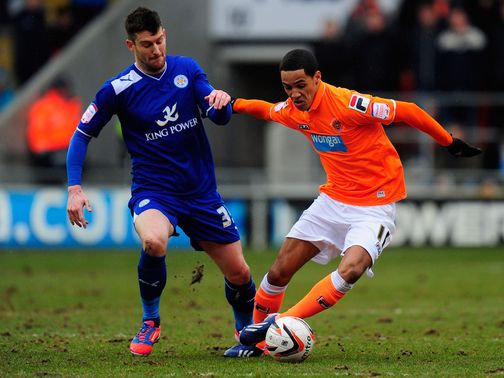 David Nugent and Thomas Ince battle for the ball