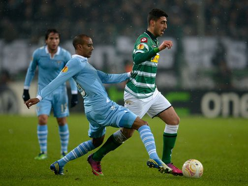 Abdoulay Konko tries to tackle Tolga Cigerci