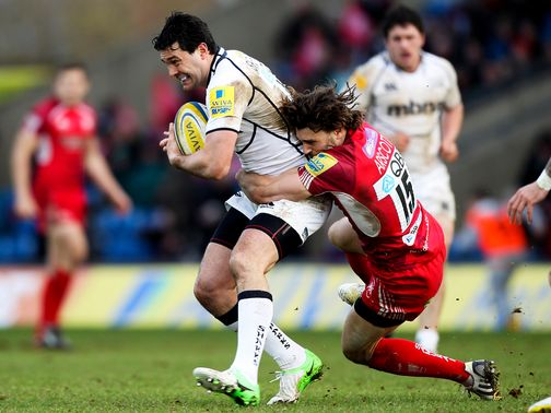 Cameron Shepherd of Sale is tackled by Tom Arscott