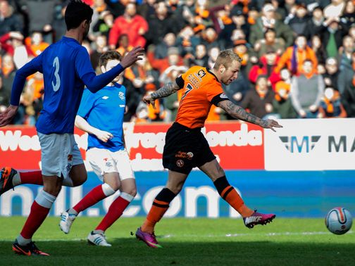 Johnny Russell puts Dundee United 1-0 up.