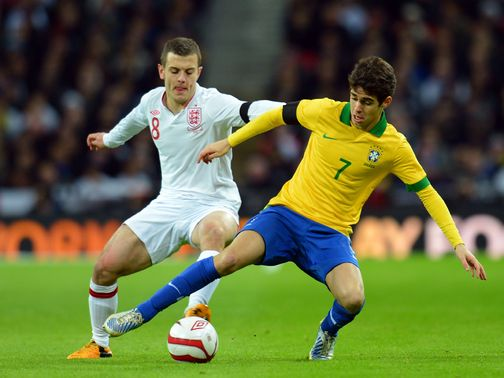 Wilshere (left) believes he can handle the pressure