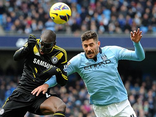 Demba Ba battles with Javi Garcia