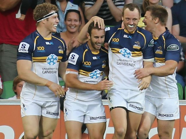 Mogg celebrates his try for the Brumbies
