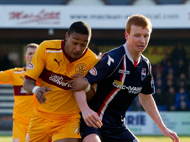 Chris Humphrey and Scott Boyd battle for the ball