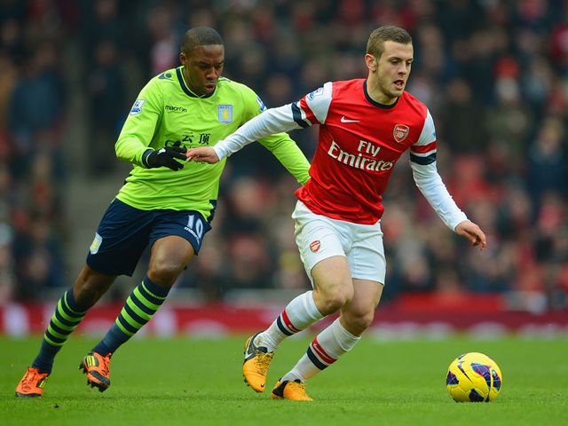 Jack Wilshere tries to break clear from Charles N Zogbia