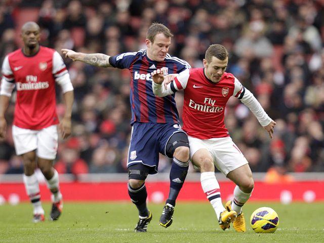 Whelan puts Wilshere under pressure.