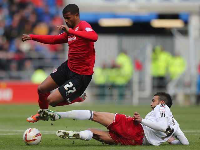 Frazier Campbell is tackled by Liam Fontaine.