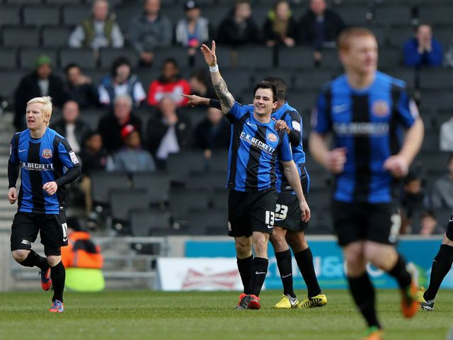 Chris Dagnall celebrates one of his two goals