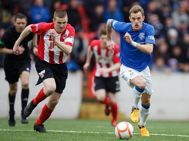 Dean Shiels gets away from John Sweeney.