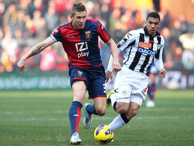 Juraj Kucka takes the ball past Marques Loureiro Allan
