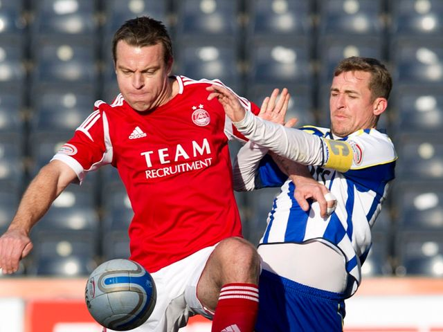 Gavin Rae and James Fowler battle for the ball