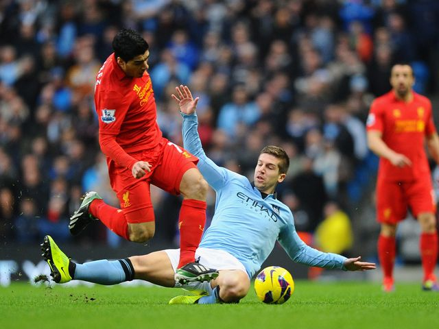 Suarez looks to escape from Nastasic.