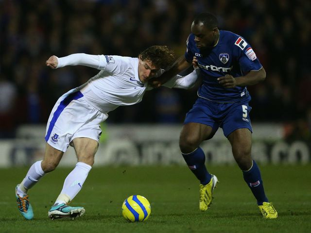Nikica Jelavic looks to keep possession.