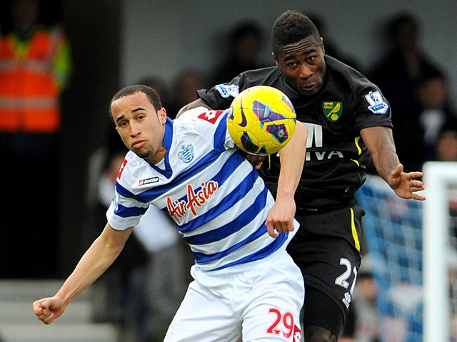Townsend and Tettey go up for a header.