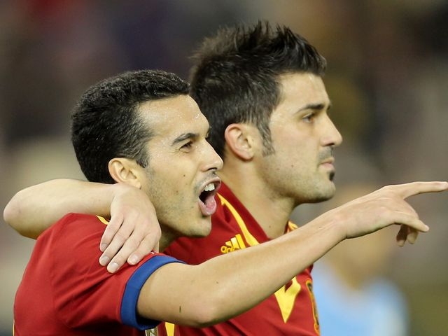 Pedro Rodriguez and David Villa celebrate for Spain
